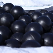 An image of black hollow plastic balls